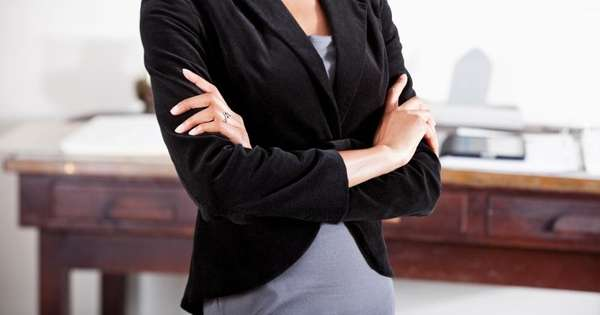 Woman standing in an office.