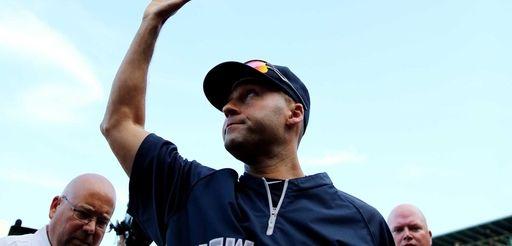 The Yankees' Derek Jeter leaves the field after
