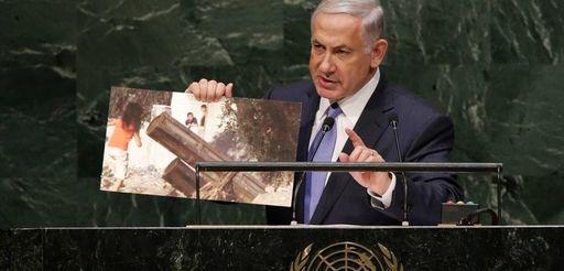 Benjamin Netanyahu, Prime Minister of Israel, holds up