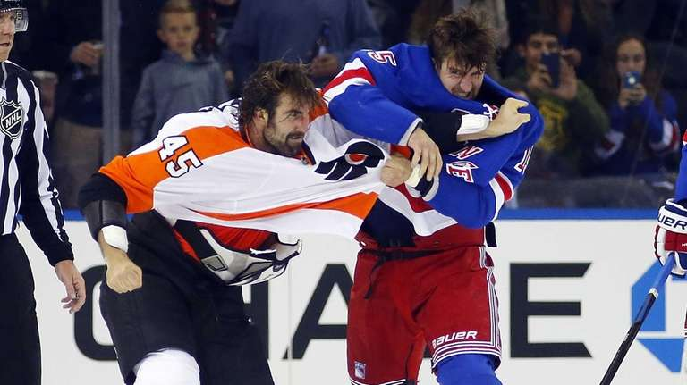 Tanner Glass #15 of the Rangers trades punches