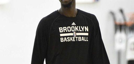 Nets center Kevin Garnett looks on during the