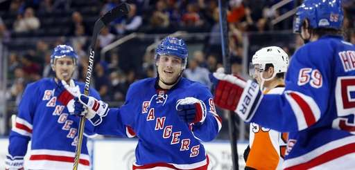 Jesper Fast #91 of the Rangers celebrates his