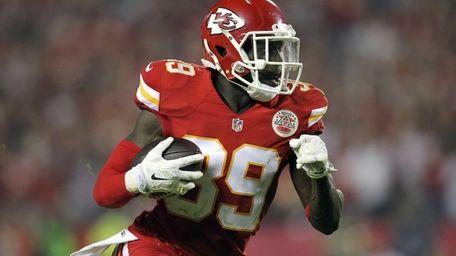 Kansas City Chiefs free safety Husain Abdullah carries