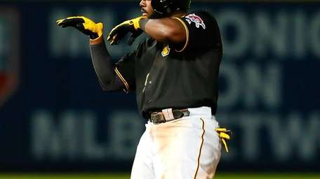 Josh Harrison of the Pittsburgh Pirates reacts after