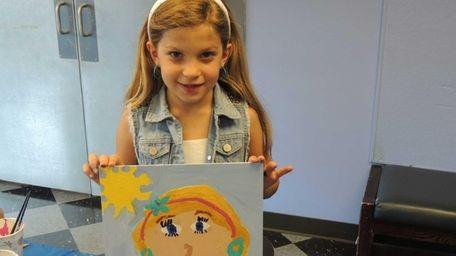 Abigail Hylan, 7, of Glen Cove, shows off