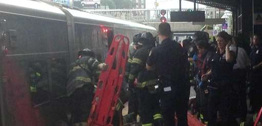 FDNY personnel work to rescue a person between