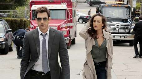 Dylan McDermott and Maggie Q in a scene