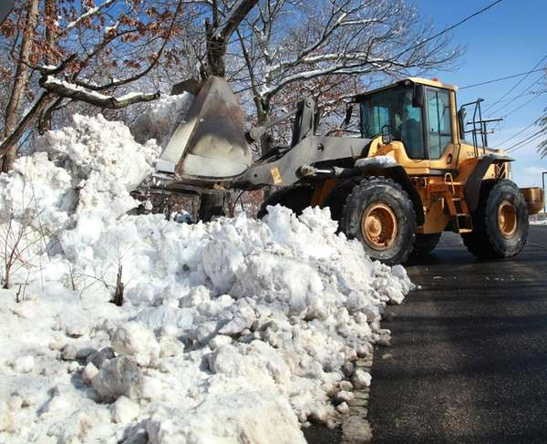 A Town of Brookhaven crew removes snow from