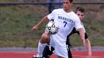 Comsewogue midfielder Jimmy Contino (7) controls the ball