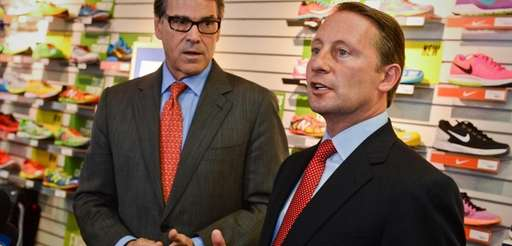 Rob Astorino, right, speaks while standing with Texas