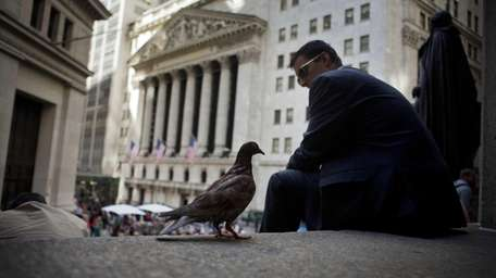 A pigeon stands on the steps of Federal