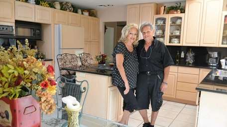 Beatrice and John Lonigro in their spacious and