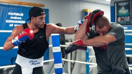 Chris Algieri and trainer Keith Trimble spar at