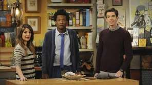 Roommates John (John Mulaney, right), Motif (Seaton Smith,