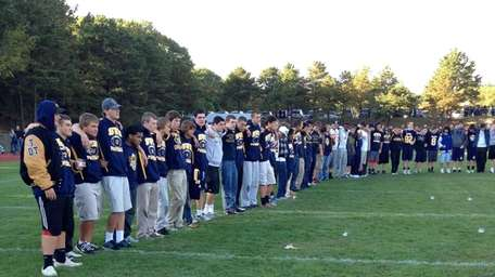 Students gather on the football field at Shoreham-Wading