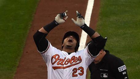 Nelson Cruz #23 of the Baltimore Orioles celebrates