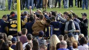 Shoreham-Wading River High School football players come together