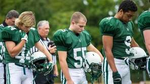 Members of the Locust Valley football team pause