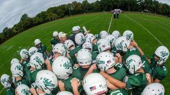 Locust Valley huddles prior to their game against