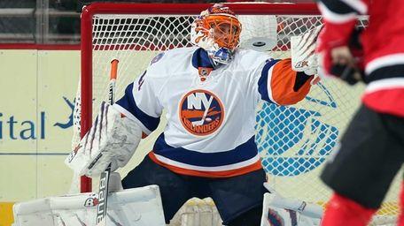 Jaroslav Halak of the Islanders makes the first-period