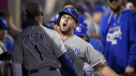Kansas City Royals' Mike Moustakas celebrates his home