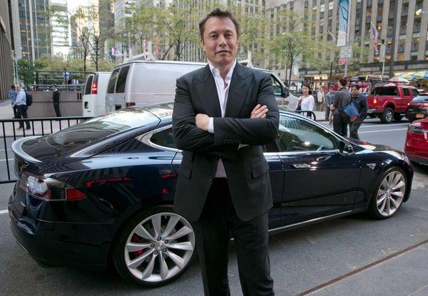 Tesla Motors CEO Elon Musk beside a Tesla