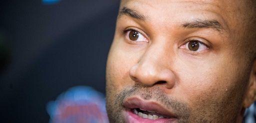 Knicks head coach Derek Fisher speaks to the