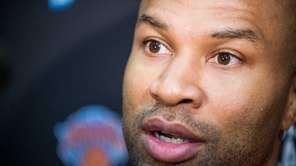 Knicks head coach Derek Fisher speaks to the