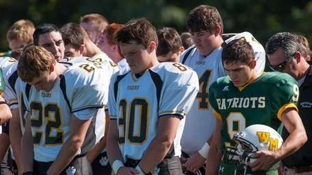 Players for both Ward Melville and Northport take