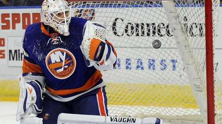 Islanders goalie Chad Johnson watches as the first