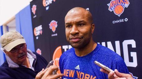 Knicks head coach Derek Fisher talks to the