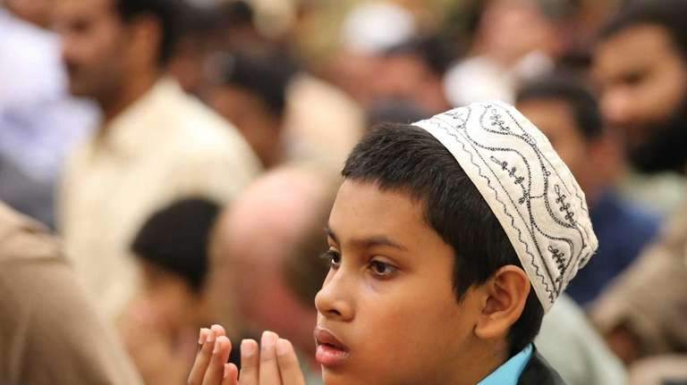 Kamrul Hassan, 11, of Bay Shore, joins hundreds