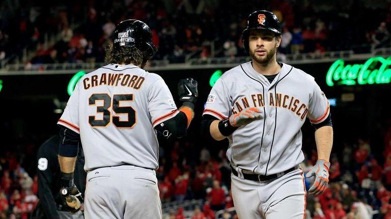 Brandon Belt of the San Francisco Giants celebrates