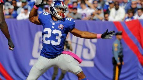 Giants running back Rashad Jennings #23 celebrates after