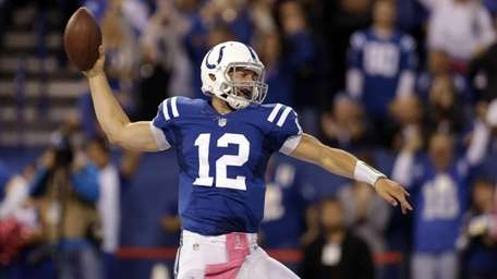 Indianapolis Colts quarterback Andrew Luck celebrates a touchdown