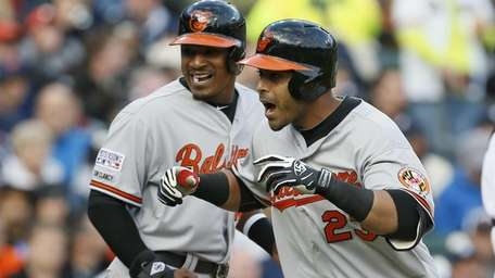 The Baltimore Orioles' Nelson Cruz (23) celebrates with