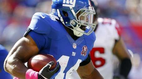 Andre Williams #44 of the Giants runs the