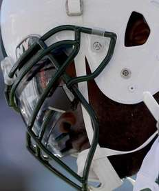 Jets quarterback Michael Vick looks down after a