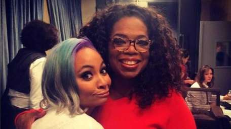 Actress-singer Raven-Symoné and Oprah pose after The Cosby