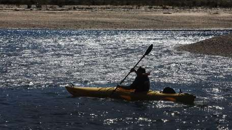 A man in a kayak begins his journey