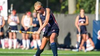 Manhasset's Caitlyn Kenny (3) hits the ball in