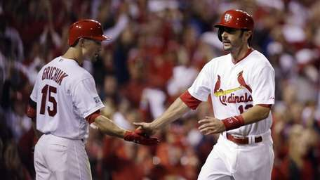 St. Louis Cardinals third baseman Matt Carpenter, right,