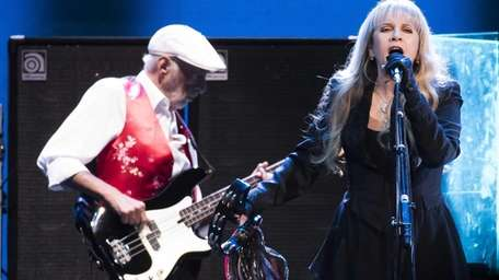 Fleetwood Mac's John McVie, left, and Stevie Nicks,