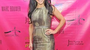 Teresa Giudice attends the 2011 Pop Art Halloween