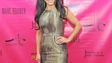 Teresa Giudice attends the 2011 Pop Art Halloween