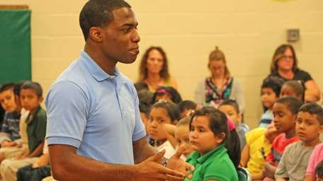 Jamel Hudson, 19, of Brentwood, lectures students at