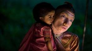 Jyoti Amge as Ma Petite and Naomi Grossman