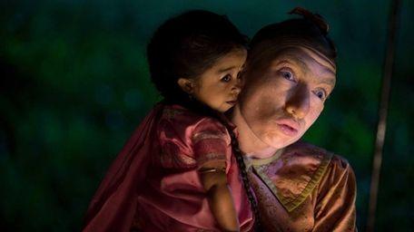 Jyoti Amge as Ma Petite and Naomi Grossman
