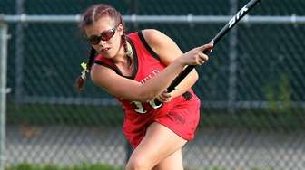 Newfield defender Katie Neiva clears the ball out