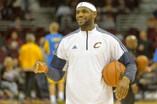 LeBron James #23 of the Cleveland Cavaliers warms